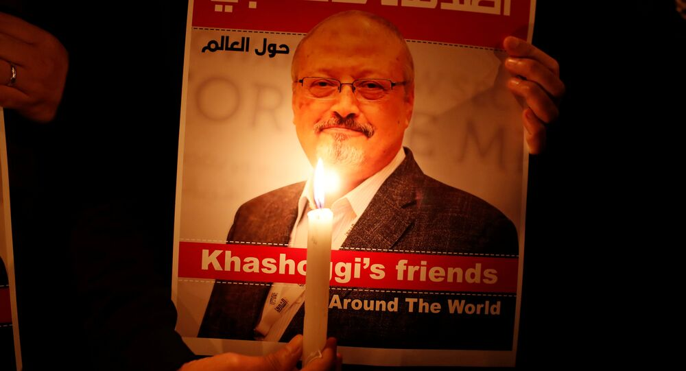 A demonstrator holds a poster with a picture of Saudi journalist Jamal Khashoggi