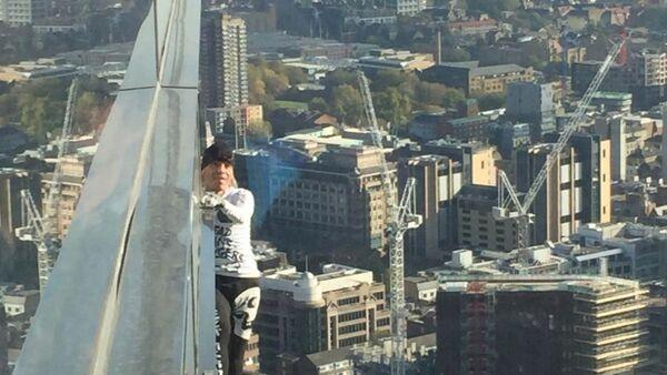 Alain Robert, known as 'Spiderman', climbs the Heron Tower in London - Sputnik International