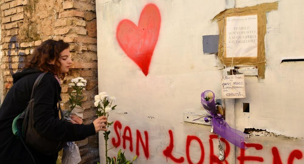 A tribute to Desirée Mariottini outside the abandoned building where she was found in the San Lorenzo district