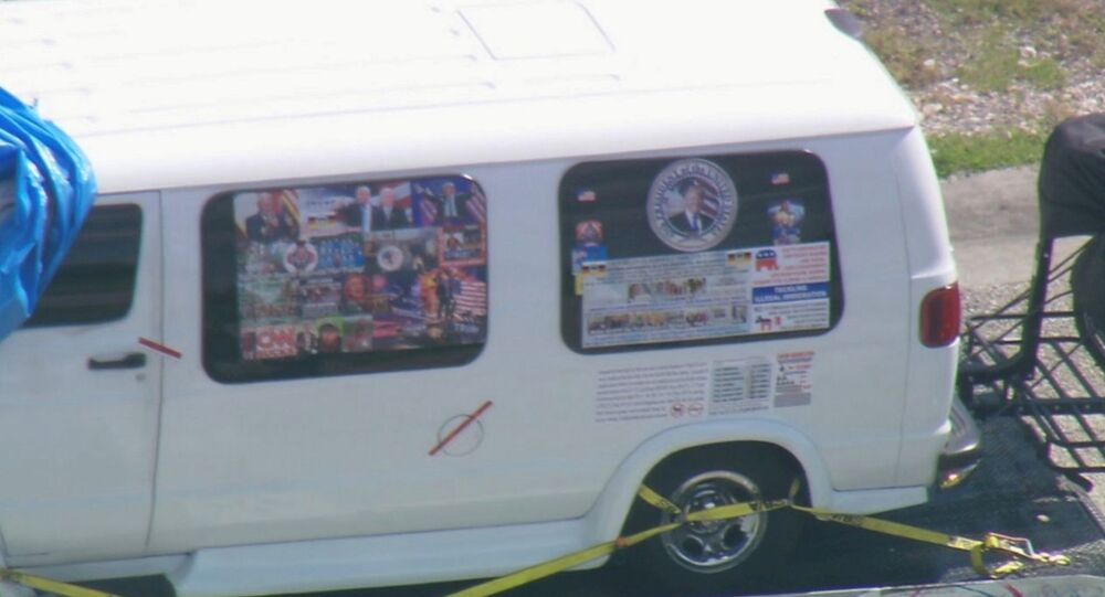 A van which was seized during an investigation into a series of parcel bombs is transported to an FBI facility in Miramar