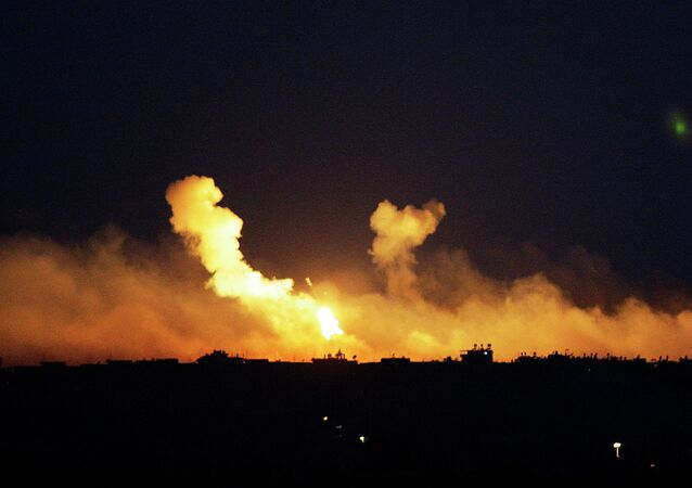The sky is illuminated by explosions from Israeli military operations over the outskirts of Gaza City as seen from the Israel-Gaza Border. FILE PHOTO