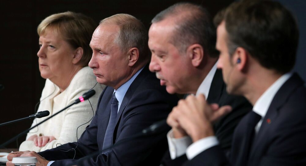 German Chancellor Angela Merkel, Russian President Vladimir Putin, Turkish President Tayyip Erdogan and French President Emmanuel Macron attend a news conference at the Syria summit in Istanbul, Turkey, October 27 2018.