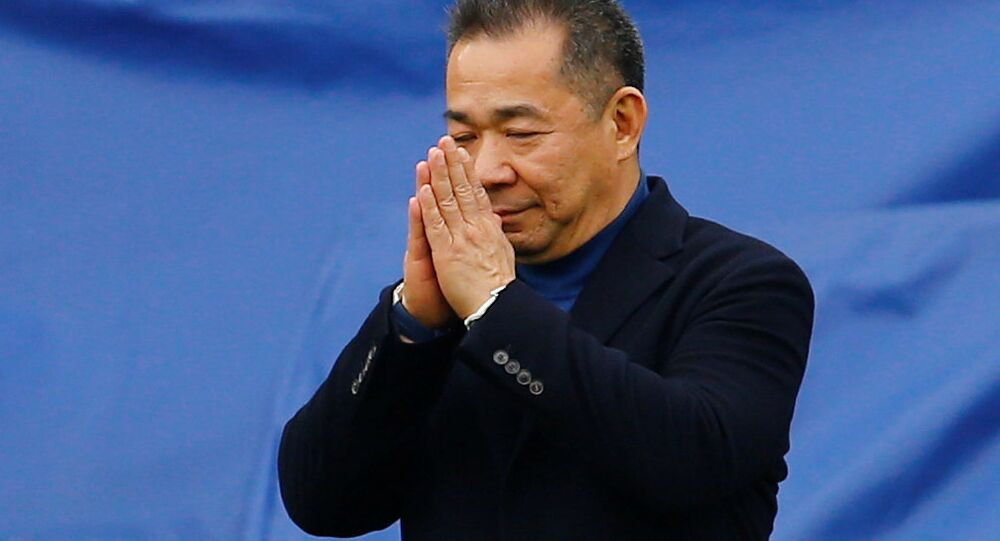 Leicester City chairman Vichai Srivaddhanaprabha reacts as he walks to his helicopter which has landed on the pitch after a game