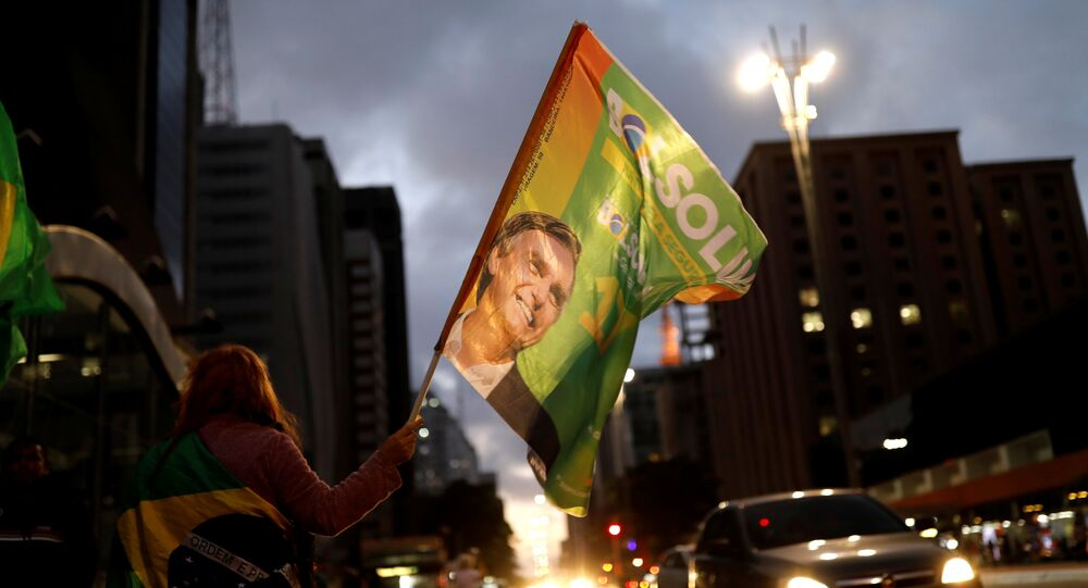 Supporters of Jair Bolsonaro, far-right lawmaker and presidential candidate of the Social Liberal Party (PSL), react during a runoff election in Sao Paulo, Brazil October 28, 2018