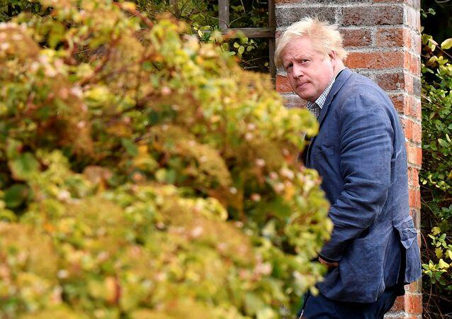 Conservative MP Boris Johnson walks through his garden at his home near Oxford, Britain, October 3, 2018.