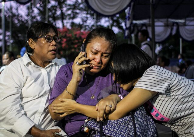 Relatives of passengers on Lion Air flight JT610, that crashed into the sea, cry as they wait at Halim Perdanakusuma Airport in Jakarta.