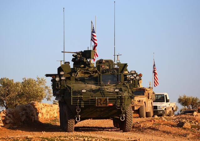A convoy of US forces armoured vehicles drives near the village of Yalanli, on the western outskirts of the northern Syrian city of Manbij, on March 5, 2017
