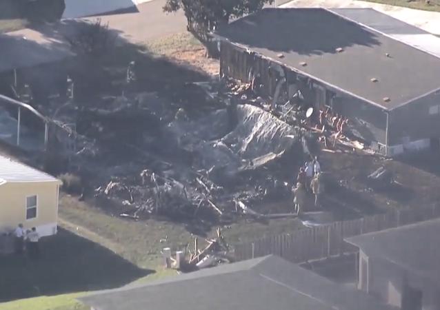 Smoldering aftermath of a gyroplane crash in Sebring, Florida