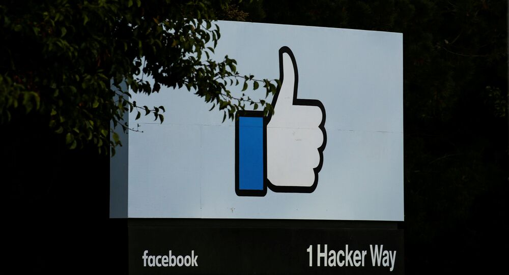 The entrance sign to Facebook headquarters is seen in Menlo Park, California, on Wednesday, October 10, 2018