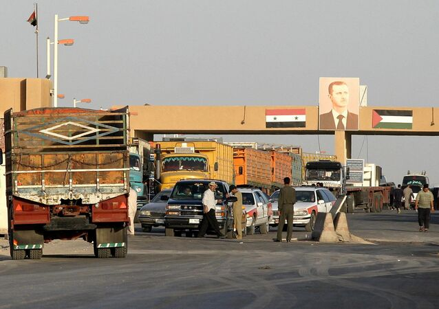 Cars wait at a checkpoint at the Syrian-Iraqi border, 270kms north-east of Damascus (File)