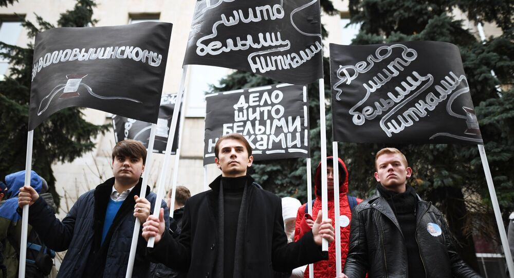 People rally outside the Ukrainian Embassy in Moscow to protest the detention of head of the RIA Novosti Ukraine news portal Kirill Vyshinsky