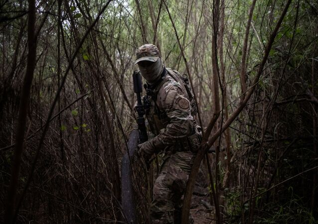 An agent with the U.S. Border Patrol Tactical Unit (BORTAC) searches a pathway near the Rio Grand river used by families who illegally cross into the United States from Mexico in Fronton, Texas, U.S., October 18, 2018. Picture taken October 18, 2018