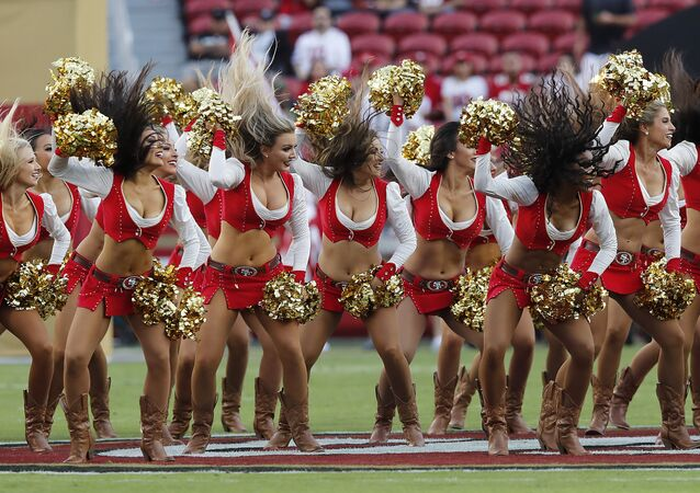 San Francisco 49ers cheerleaders perform before an NFL football game between the 49ers and the Oakland Raiders in Santa Clara, Calif., Thursday, Nov. 1, 2018.