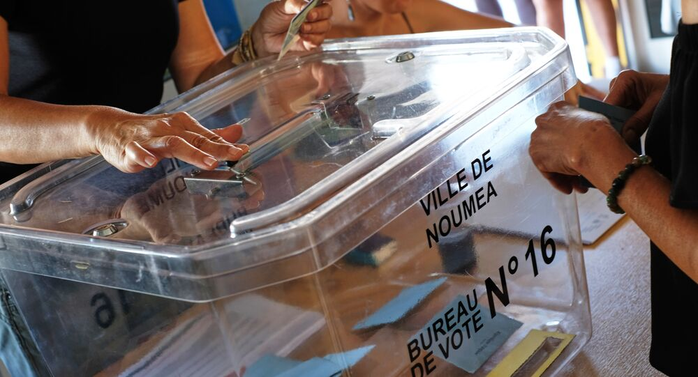 People cast their ballots for or against the independence of New Caledonia, November 4, 2018, in Noumea, New Caledonia. November 4, 2018