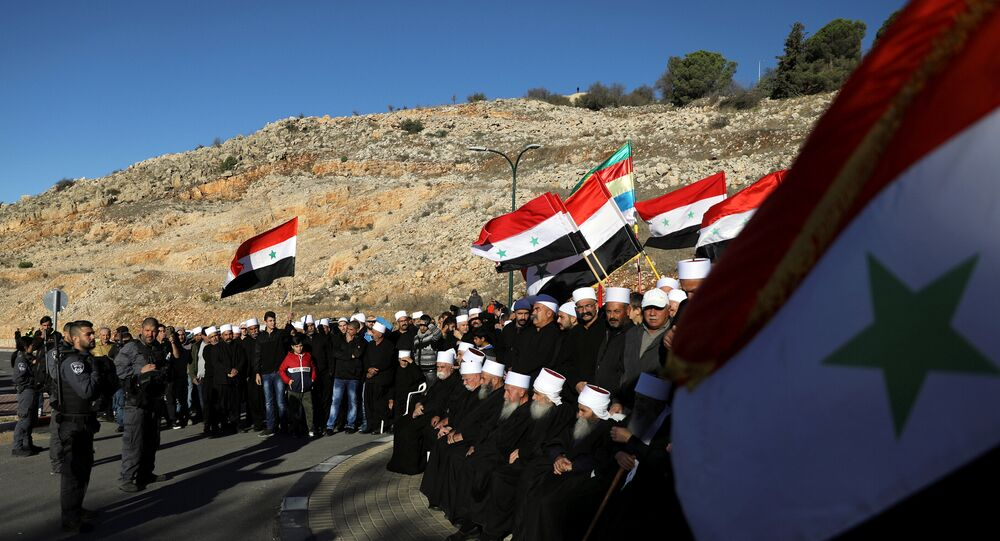 Druze Arabs on the Israeli-occupied Golan Heights hold an anti-election protest