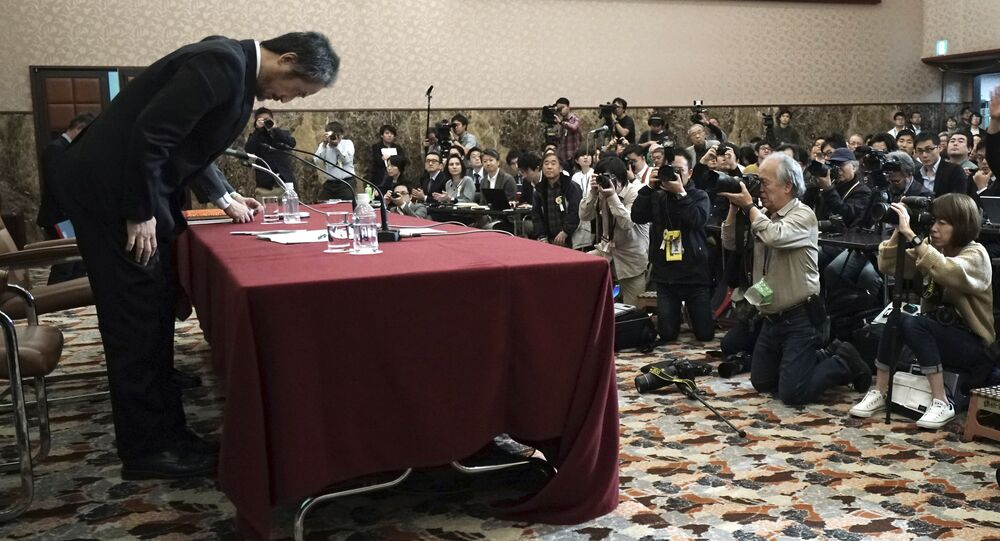 Japanese journalist Jumpei Yasuda, who was released in Syria last week after more than three years of captivity, bows at the end of his press conference in Tokyo Friday, Nov. 2, 2018.