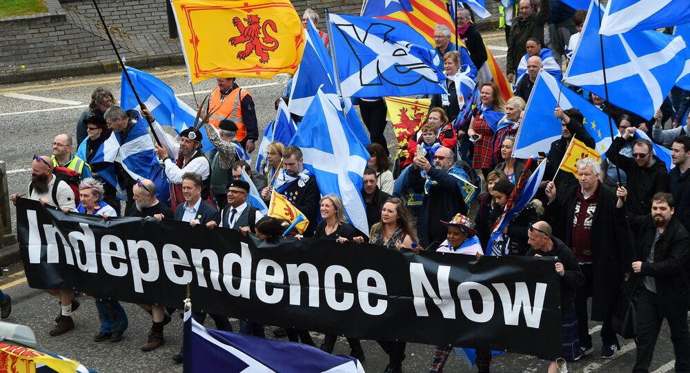 Thousands of demonstrators carry Saltire flags, the national flag of Scotland, as they march in support of Scottish independence through the streets of Glasgow, on May 5, 2018