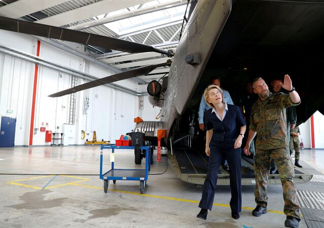 German Defence Minister Ursula von der Leyen is pictured next to a German Bundeswehr armed forces Sikorsky CH-53 helicopter of the Helicopter Wing 64 during her visit at Holzdorf Air Base, south of Berlin, Germany, July 24, 2018