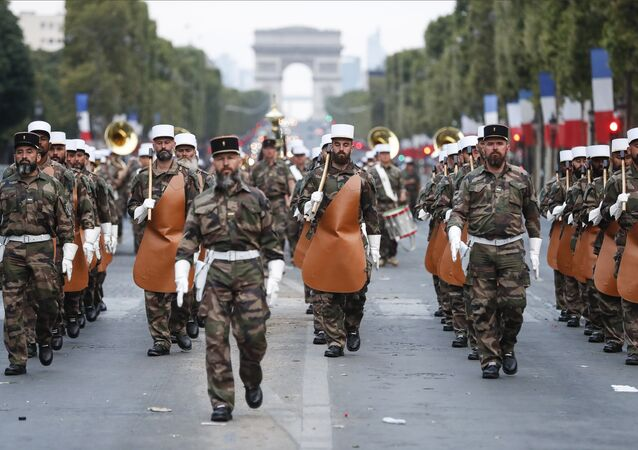 Soldiers of the French Foreign Legion parade on the Champs Elysees avenue during a rehearsal for Bastille Day, early Wednesday, July 11, 2018 in Paris.
