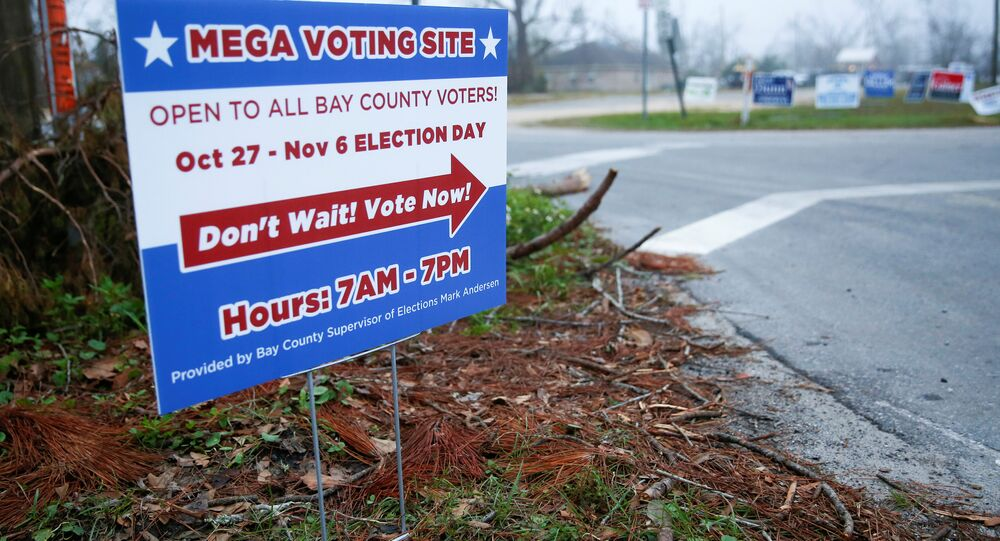 A sign directs voters to a new polling location where Hurricane Michael destroyed many schools and other buildings used as polling stations in the area in Lynn Haven, Florida, U.S., November 5, 2018