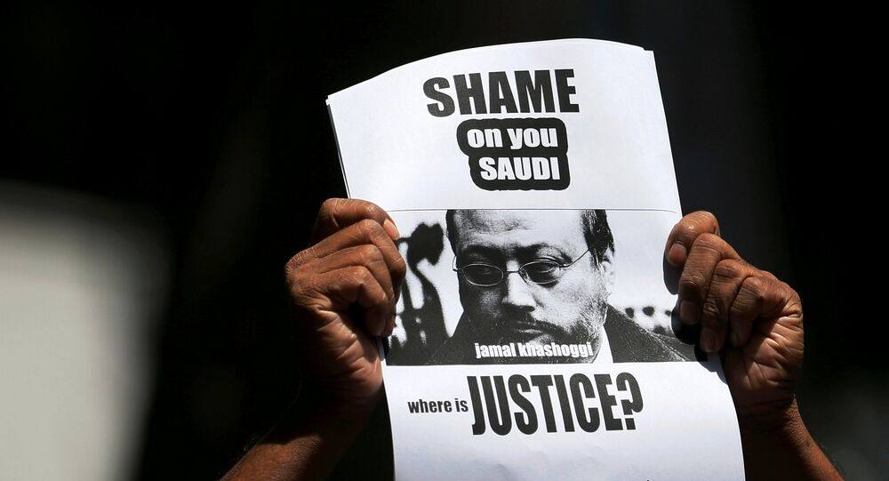 A member of Sri Lankan web journalist association holds a placard during a protest condemning the murder of slain journalist Jamal Khashoggi in front of the Saudi Embassy in Colombo, Sri Lanka October 25, 2018