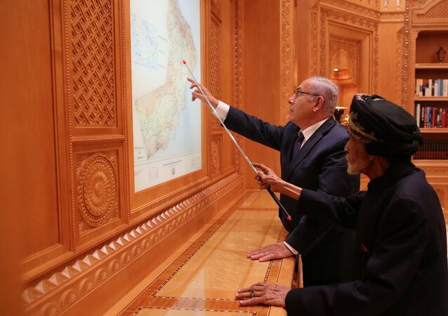 Israeli Prime Minister Benjamin Netanyahu looks at maps with Sultan Qaboos bin Said in this undated handout provided by the Israel Prime Minister Office, in Oman