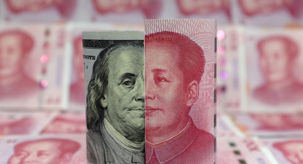 A Benjamin Franklin U.S. 100-dollar banknote and a Chinese 100-yuan banknote depicting late Chinese chairman Mao Zedong are seen in a picture illustration taken January 21, 2016