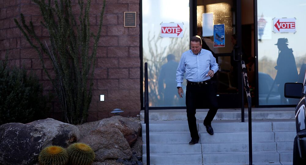 A man leaves the Carefree Town Council building after voting at a polling station in the mid-term general elections in Carefree