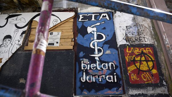 Picture shows a graffiti representing the logo of the armed Basque separatist group ETA in the northern Spanish Basque village of Bermeo - Sputnik International