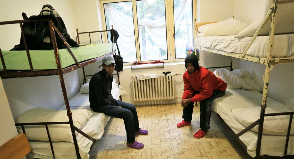 Nigerian migrants sit on beds in their room at the Bela-Jezova detention centre for refugees near Bela pod Bezdezem, northeast of Prague (File))