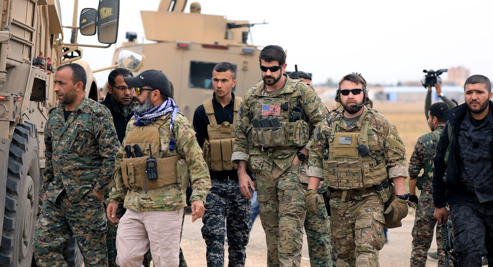 Syrian Democratic Forces and U.S. troops are seen during a patrol near Turkish border in Hasakah, Syria November 4, 2018