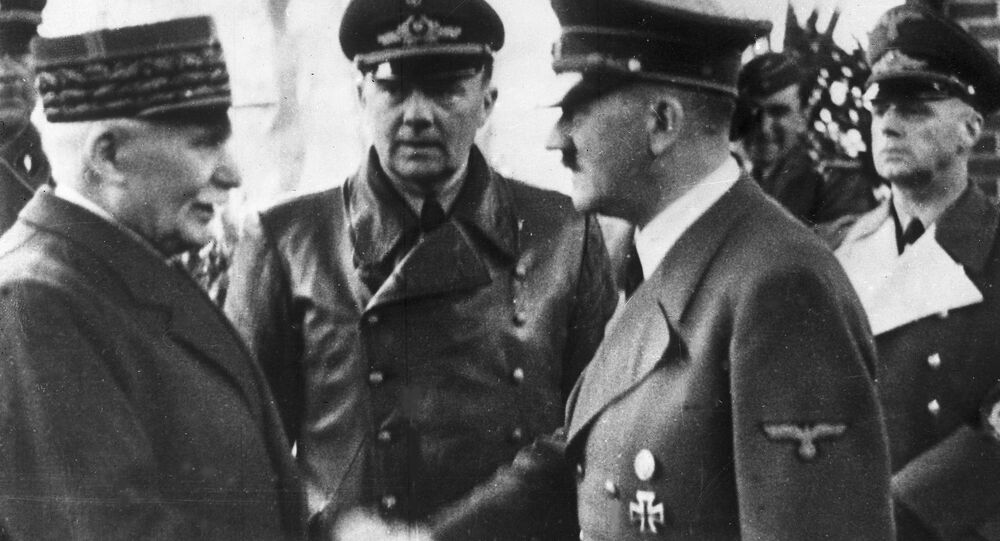 This Oct. 24, 1940 file photo shows German Chancellor Adolf Hitler, right, shaking hands with Head of State of Vichy France Marshall Philippe Petain, in occupied France.