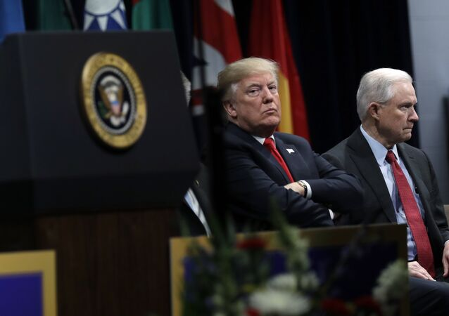 President Donald Trump, listens to FBI Director Christopher Wray speak, with Attorney General Jeff Sessions, right, at the FBI National Academy graduation ceremony, Friday, Dec. 15, 2017, in Quantico, Va.