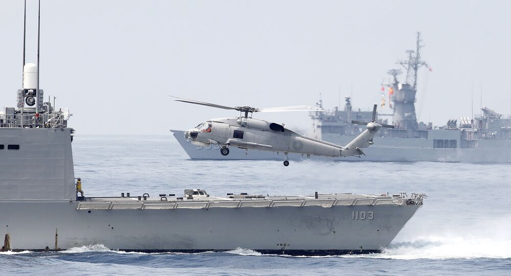 A Taiwan Navy S70 helicopter takes off from the stern of a Perry-class frigate during a navy exercise in the bound of Suao naval station in Yilan County, northeast of Taiwan, Friday, April 13, 2018