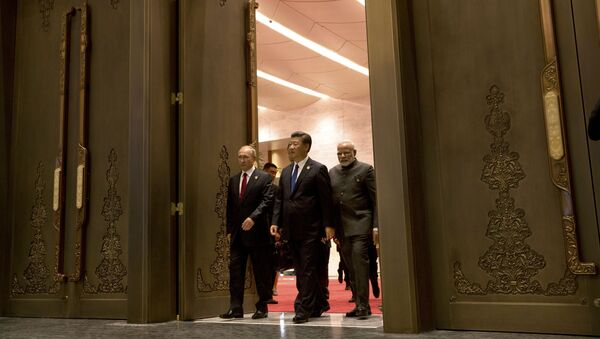 (L to R) Russian President Vladimir Putin, Chinese President Xi Jinping and Indian Prime Minister Narendra Modi arrive for the Dialogue of Emerging Market and Developing Countries on the sidelines of the 2017 BRICS Summit in Xiamen, southeastern China's Fujian Province on September 5, 2017 - Sputnik International