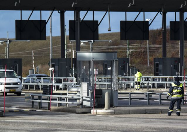 Cars arrive from Denmark to the toll and customs station at Lernacken on the Swedish side of the Oresund strait Thursday Nov. 12, 2015