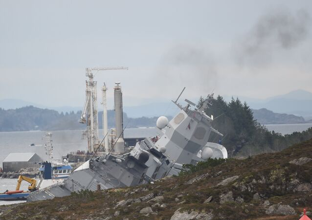 Norwegian frigate KNM Helge Ingstad takes on water after a collision with the tanker Sola TS in Oygarden