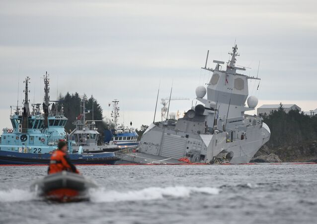 The Norwegian frigate KNM Helge Ingstad takes on water after a collision with the tanker Sola TS in Oygarden, Norway, November 8, 2018