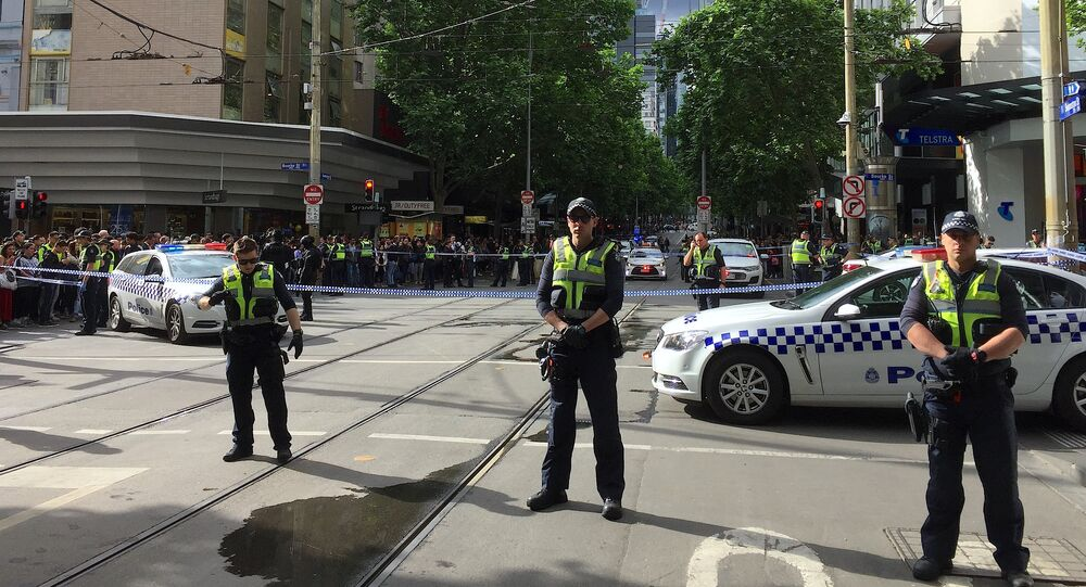 Policemen block members of the public from walking towards the Bourke Street mall in central Melbourne, Australia, November 9, 2018