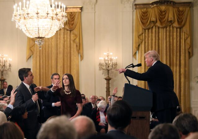 A White House staff member reaches for the microphone held by CNN's Jim Acosta as he questions U.S. President Donald Trump during a news conference following Tuesday's midterm U.S. congressional elections at the White House in Washington, U.S., November 7, 2018