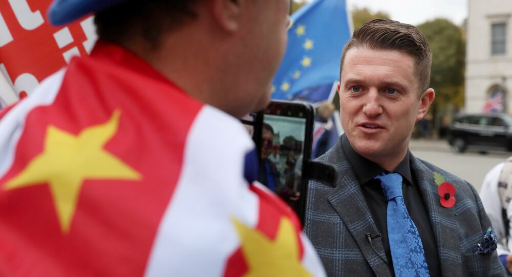 Tommy Robinson speaks to an anti-Brexit demonstrator outside the Houses of Parliament in London, Britain, November 6, 2018