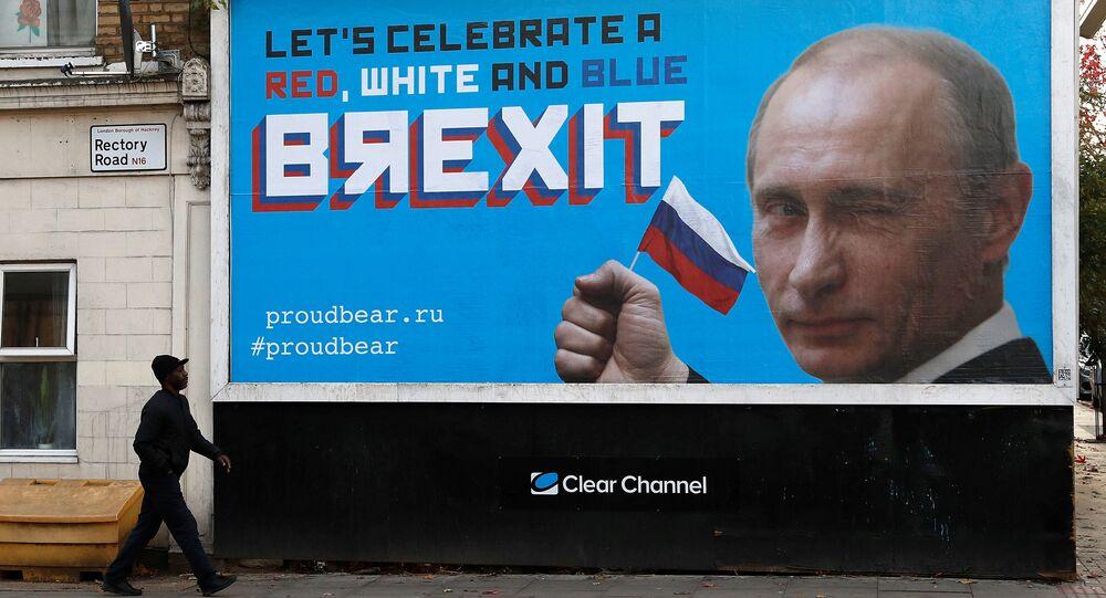 A man walks past a billboard poster in London, Britain, November 8, 2018