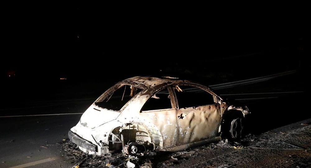 An abandoned vehicle is seen on a road during California Wildfire.