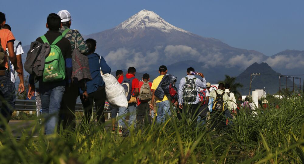 Central American migrants begin their morning trek as part of a thousands-strong caravan hoping to reach the U.S. border, as they face the Pico de Orizaba volcano upon departure from Cordoba, Veracruz state, Mexico, Monday, Nov. 5, 2018. A big group of Central Americans pushed on toward Mexico City from a coastal state Monday, planning to exit a part of the country that has long been treacherous for migrants seeking to get to the United States.