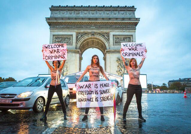 Femen activists protest against war criminals in Paris, France