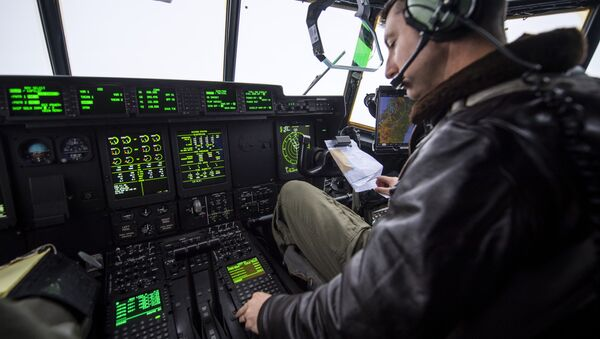A pilot from the US Marines flys a C-130 transport aircraft as part of the NATO Trident Juncture 2018 exercise departing from Orland Air Base near Brekstad, Norway, October 31, 2018. - Sputnik International