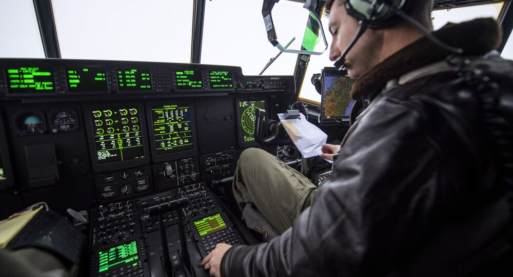 A pilot from the US Marines flys a C-130 transport aircraft as part of the NATO Trident Juncture 2018 exercise departing from Orland Air Base near Brekstad, Norway, October 31, 2018.