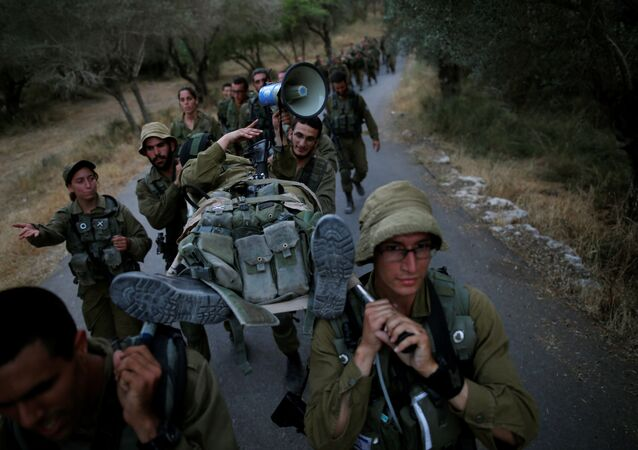 Israeli soldiers of the Search and Rescue brigade carry their comrade on a stretcher during a training session in Ben Shemen forest, near the city of Modi'in May 23, 2016