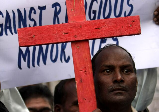Pakistani Christian protesters rally to condemn the arrest of Christian woman Asia Bibi in Karachi, Pakistan on Thursday, Nov. 25, 2010.
