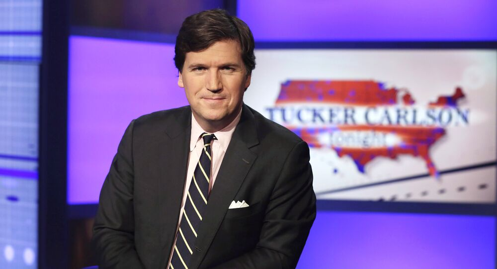 Tucker Carlson, host of Tucker Carlson Tonight, poses for photos in a Fox News Channel studio, in New York, Thursday, 2 March 2107.